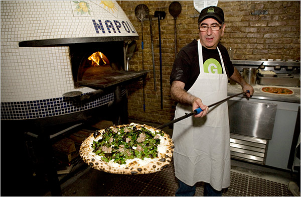 Paulie Gee himself pulling a pizza out of their Napoli wood pizza oven.  photo via the NY Times