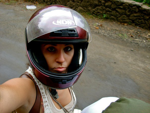 Beth on her blue Yamaha motorcycle, cruising the streets of Sao Tome and Principe.