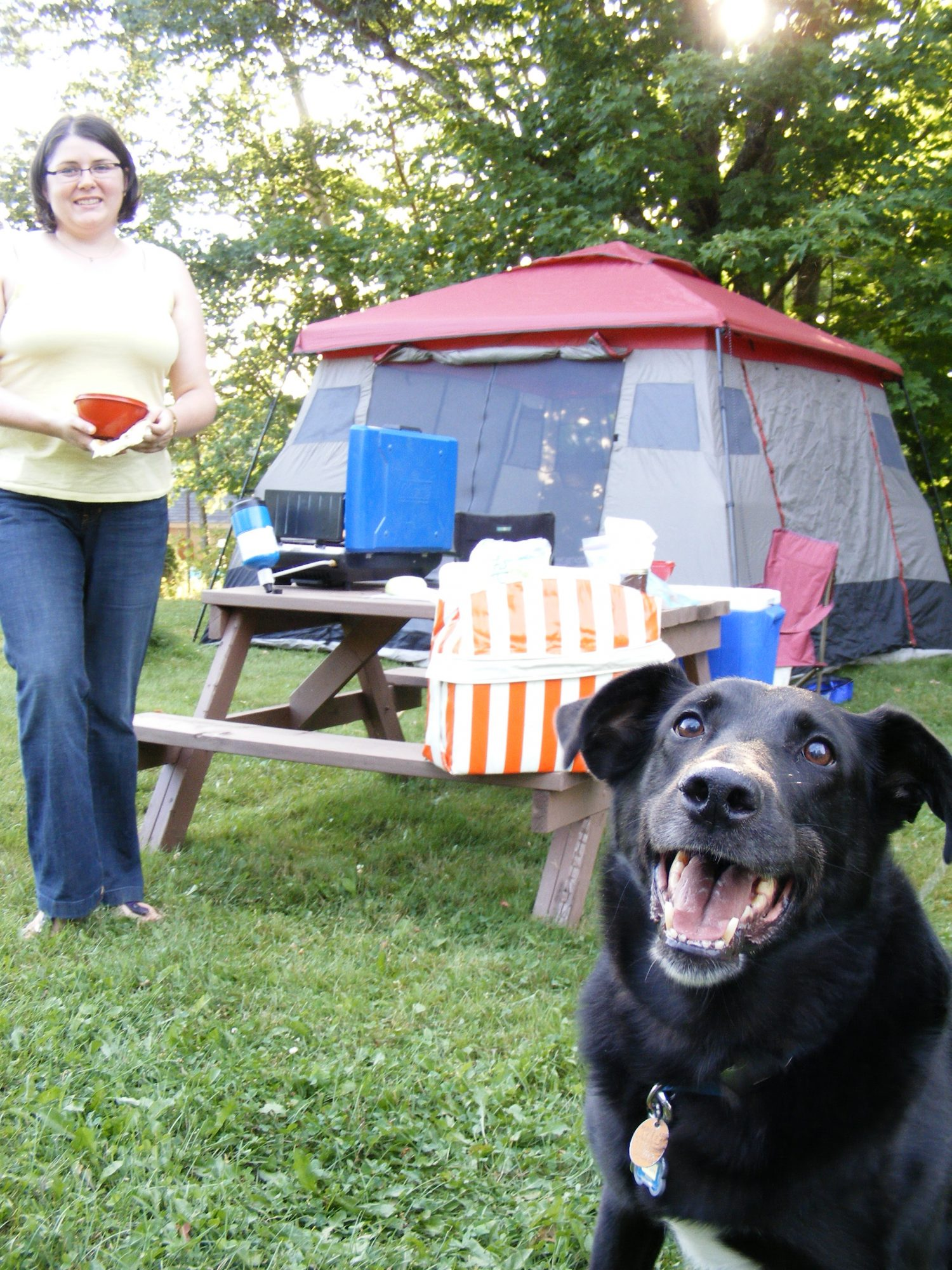 Vanessa and Chester getting ready to cook at their campsite in New Brunswick