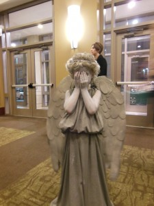 Perfect little girl cosplaying perfect Weeping Angel.