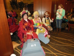 Awesome ladies cosplaying the fourth, sixth, and seventh Doctor respectively.