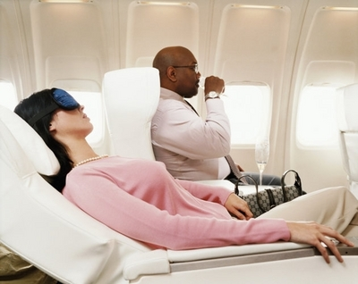 Do what you must to be comfortable while flying. Image from au.totaltravel.yahoo.com.