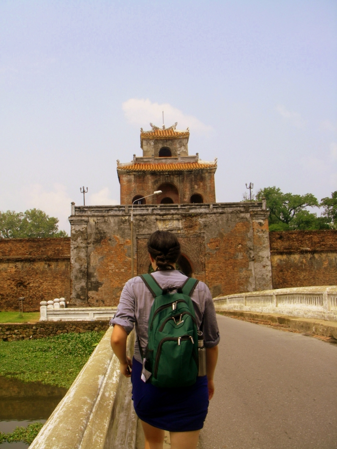 Exploring the Imperial City in Hue, Vietnam. In 1968 the site was bombed by American forces, damaging many of the buildings. Some of the structures have since been restored. Image courtesy of Kayti Burt.