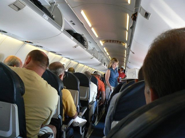 Negotiating a plane is uncomfortable for anyone. Image by Flickr user Keenan Pepper.