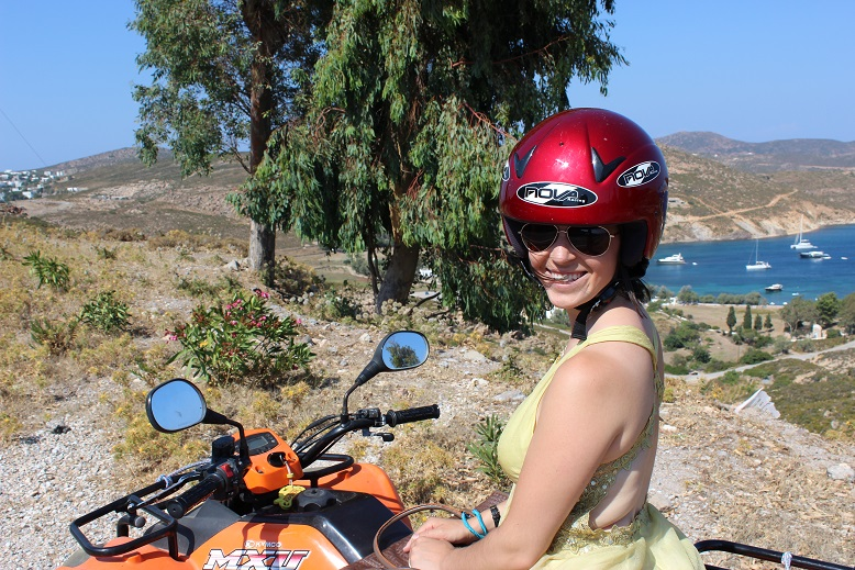 Beth of Go Girl Travel Network on an ATV in Patmos, Greece