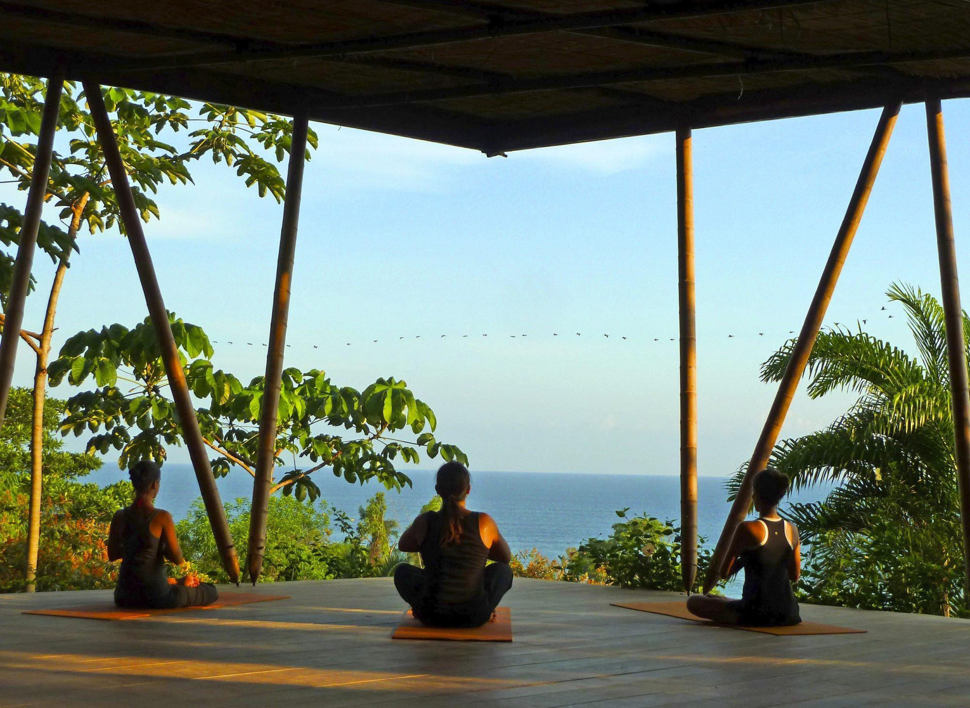 Women doing Yoga at WHOA Travel escape