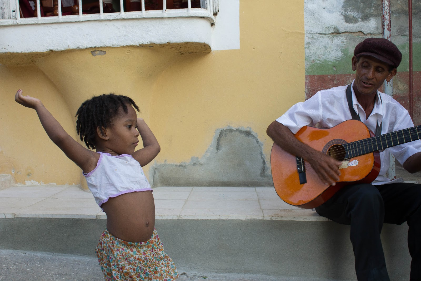 dancing girl while man plays guitar trinidad cuba