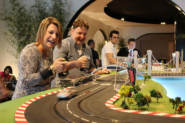 Elena of LiveDoGrow and Ryan of Turnipseed Travel race cars at the Turkish Airlines Lounge in Istanbul