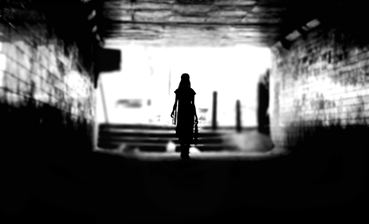 woman walking through a tunnel