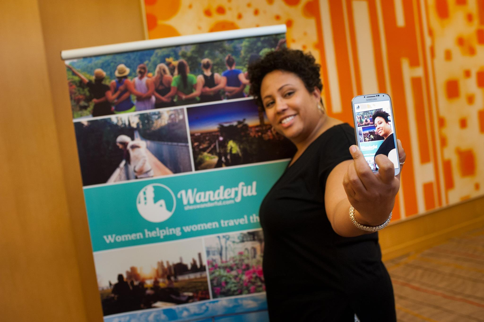 travel for black women - taking a selfie at the Women in Travel Summit by Wanderful to stay connected to travel lovers everywhere
