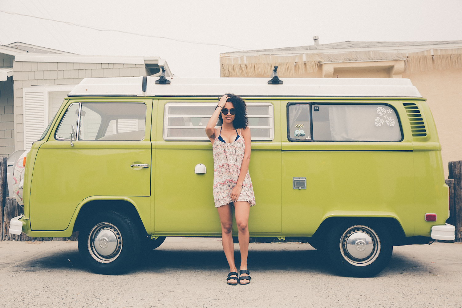 Woman standing in front of a VW van - a guide for solo travel for Black women
