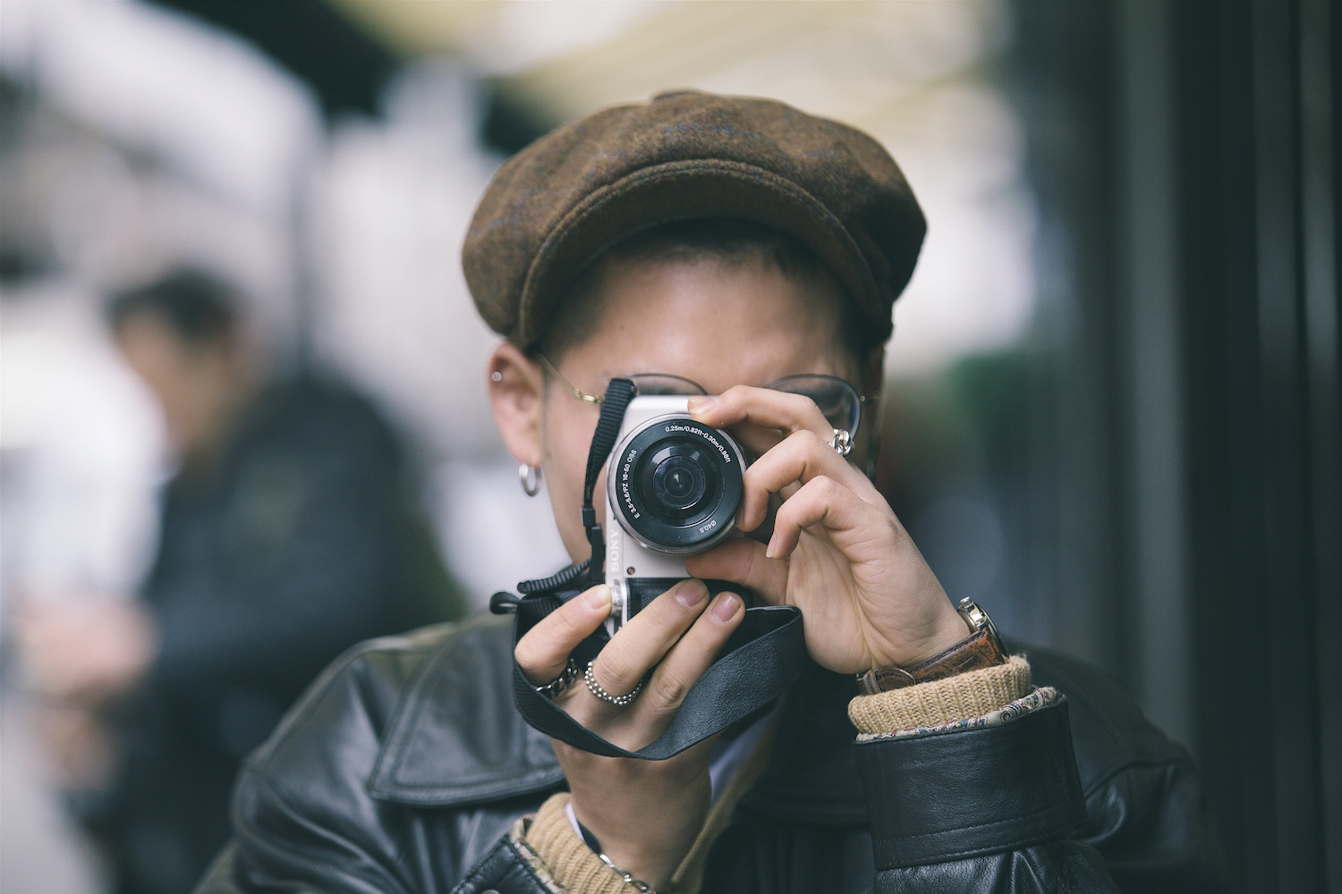 Close-up of a person taking a photo of you
