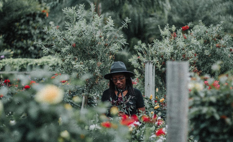 Black woman standing among shrubbery