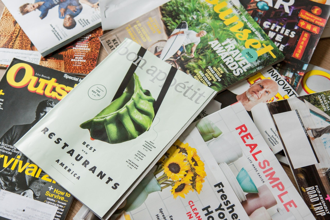 travel magazines on a table