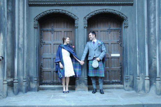 travel love stories from Amanda Walkins - her wedding photo holding hands in Edinburgh