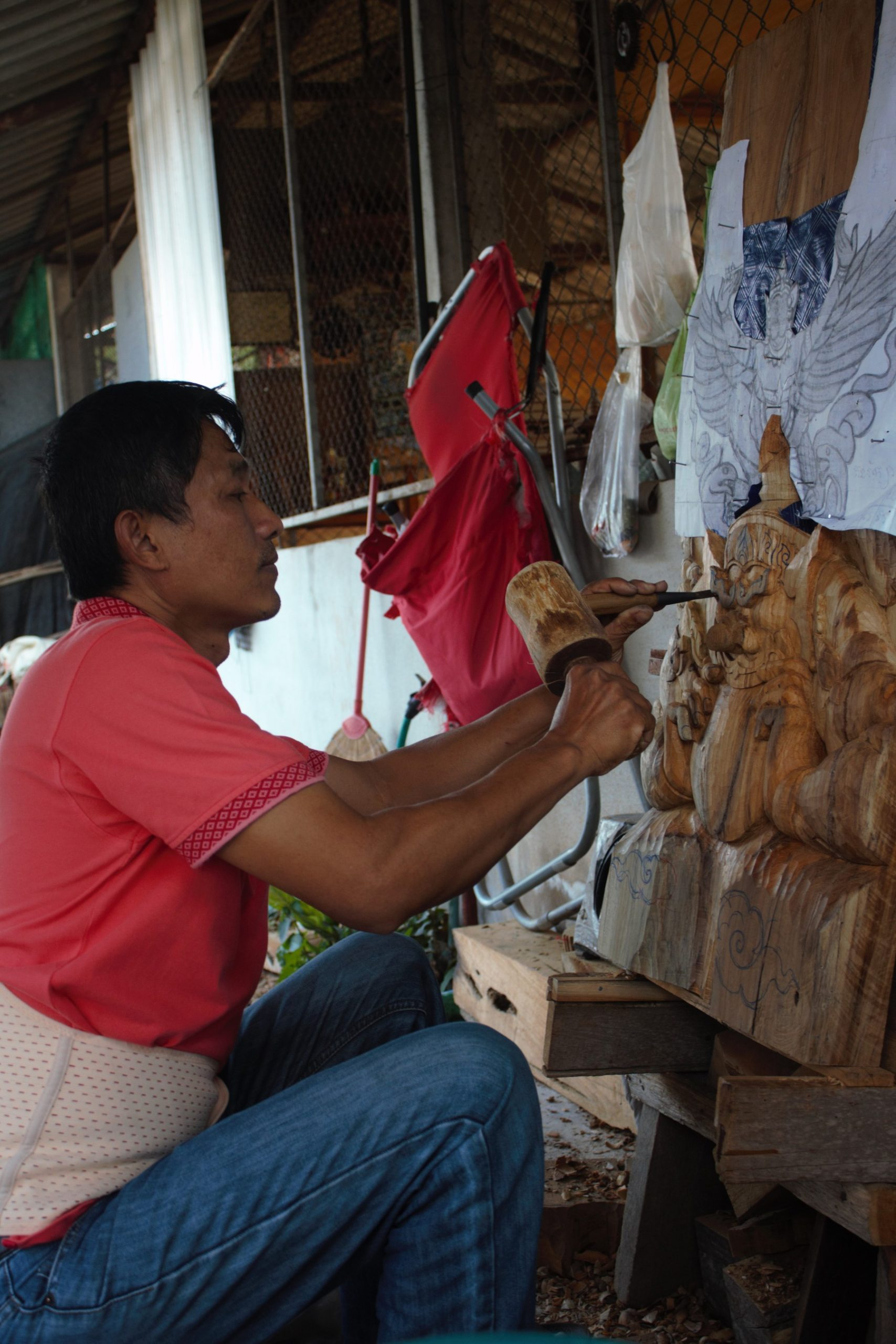 an artisan at work with wood crafts