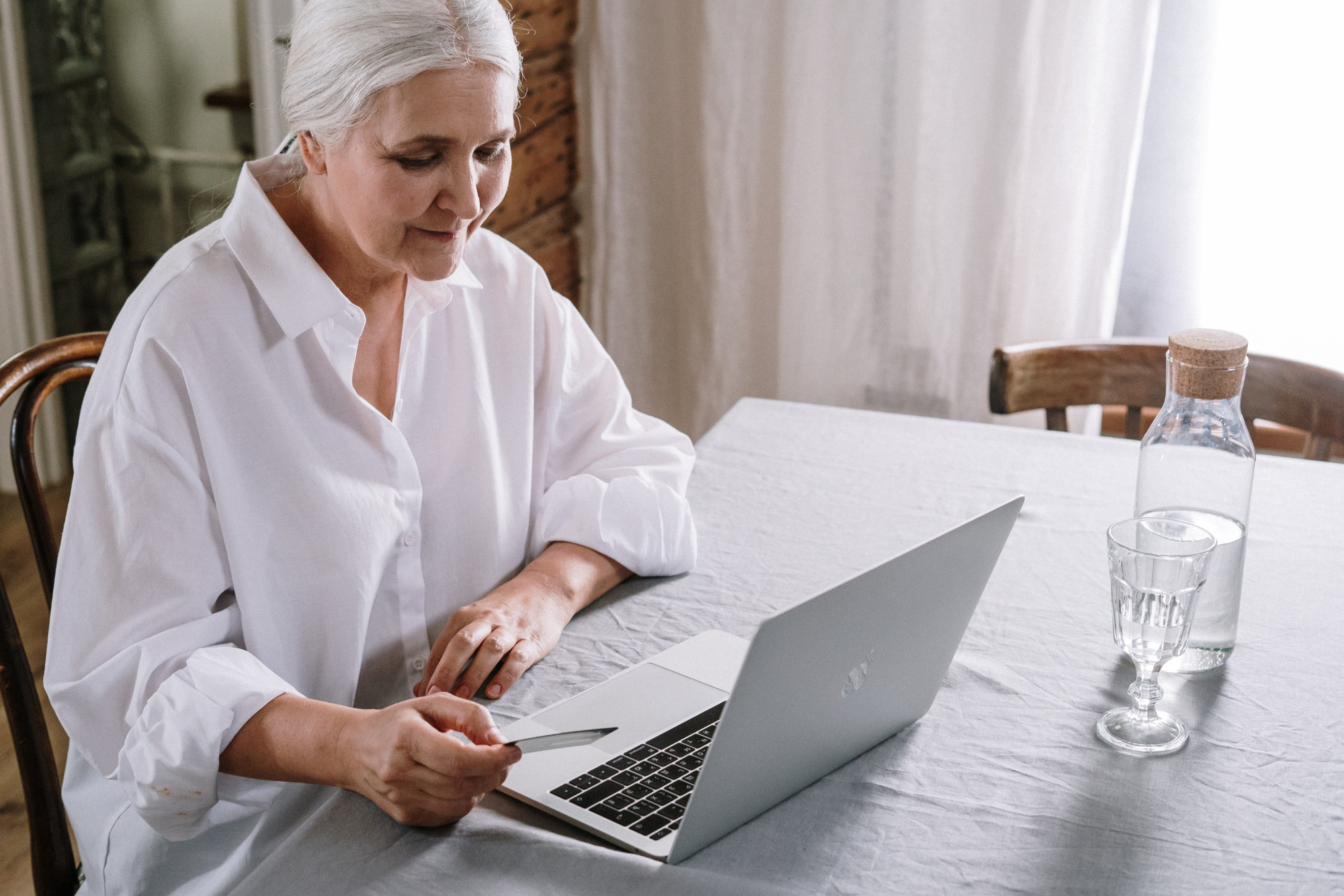 older woman using a laptop to build a blog community