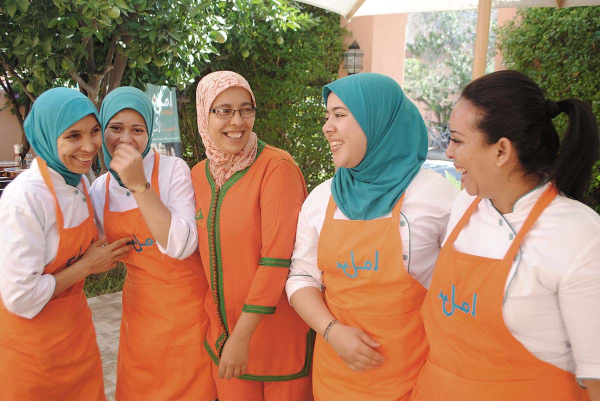 five women laughing in uniform at the Amal Association in Marrakech Morocco