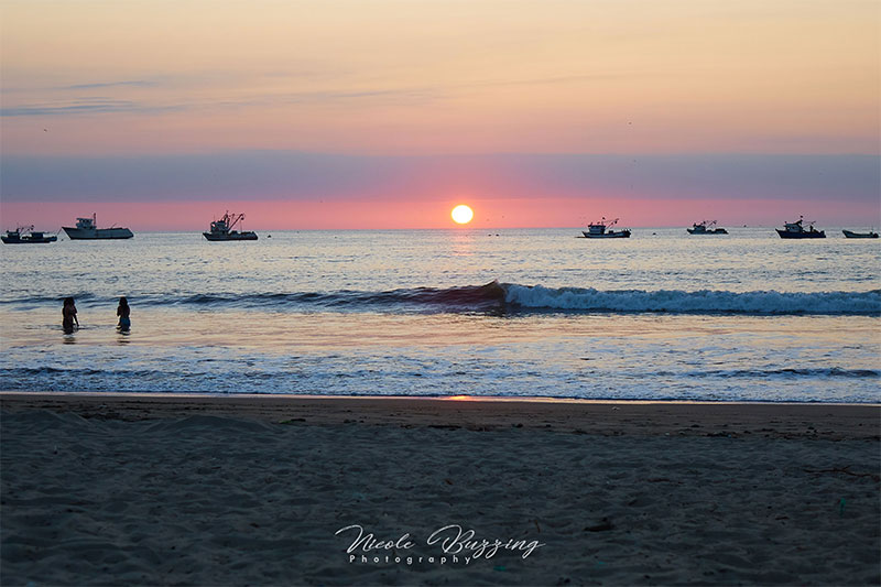 Sunset at the beach in Puerto Lopez Ecuador -- Nicole Buzzing for Wanderful