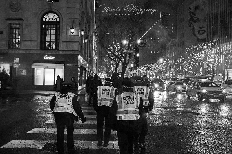 black and white image of Chicago police in the streets by Nicole Buzzing for Wanderful