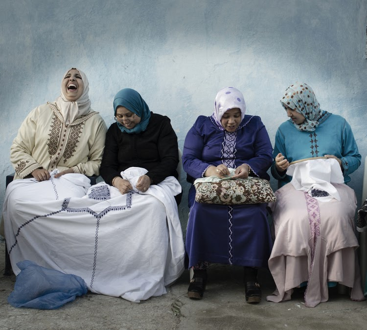 Four women sitting and laughing at the Nzala Women's Cooperative near Fes in Morocco