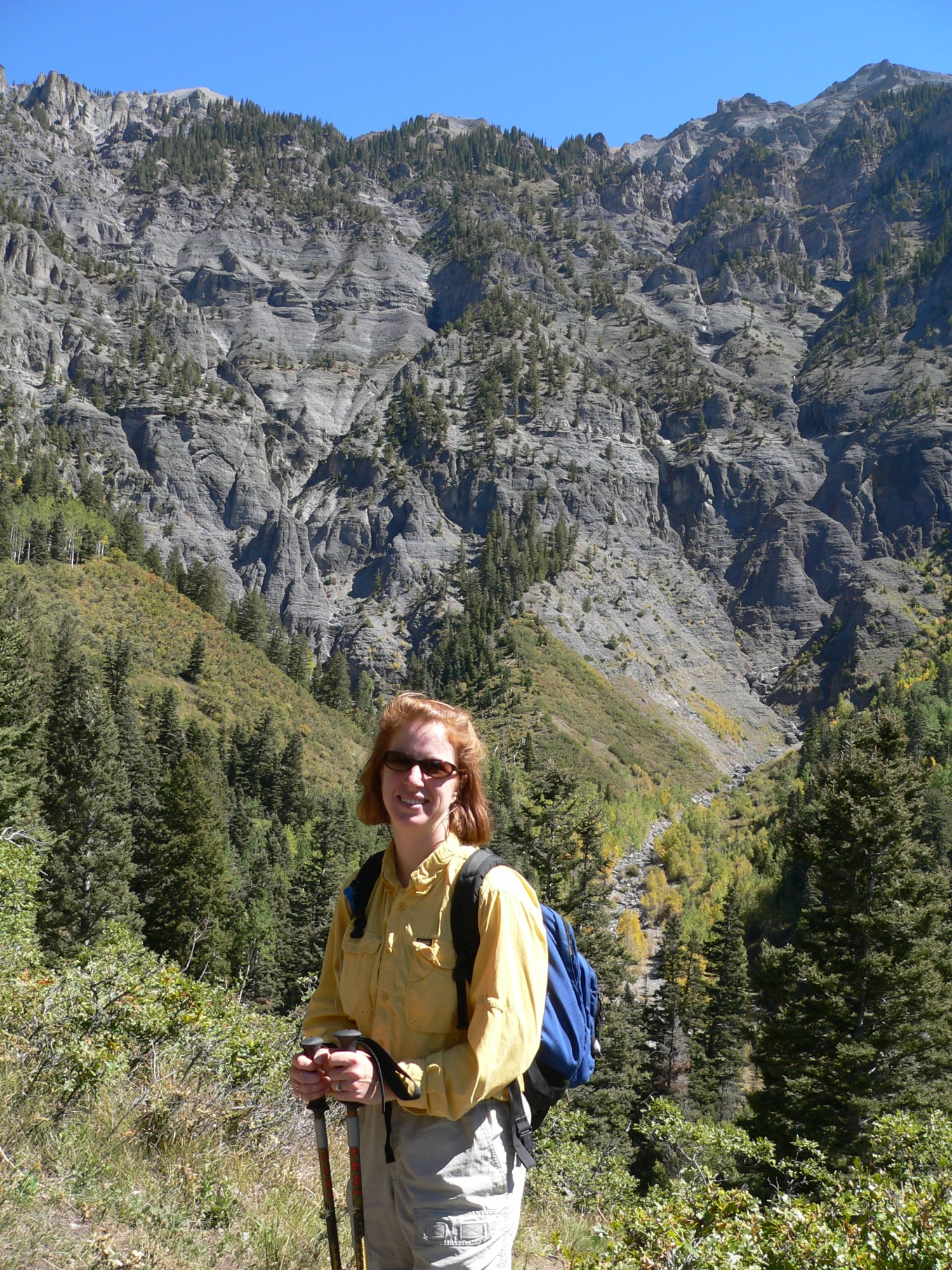 "Becki Rupp of Trailblazer Wellness standing in Ouray, Colorado, which is in the San Juan mountains and is sometimes referred to as ""The Switzerland of America"""