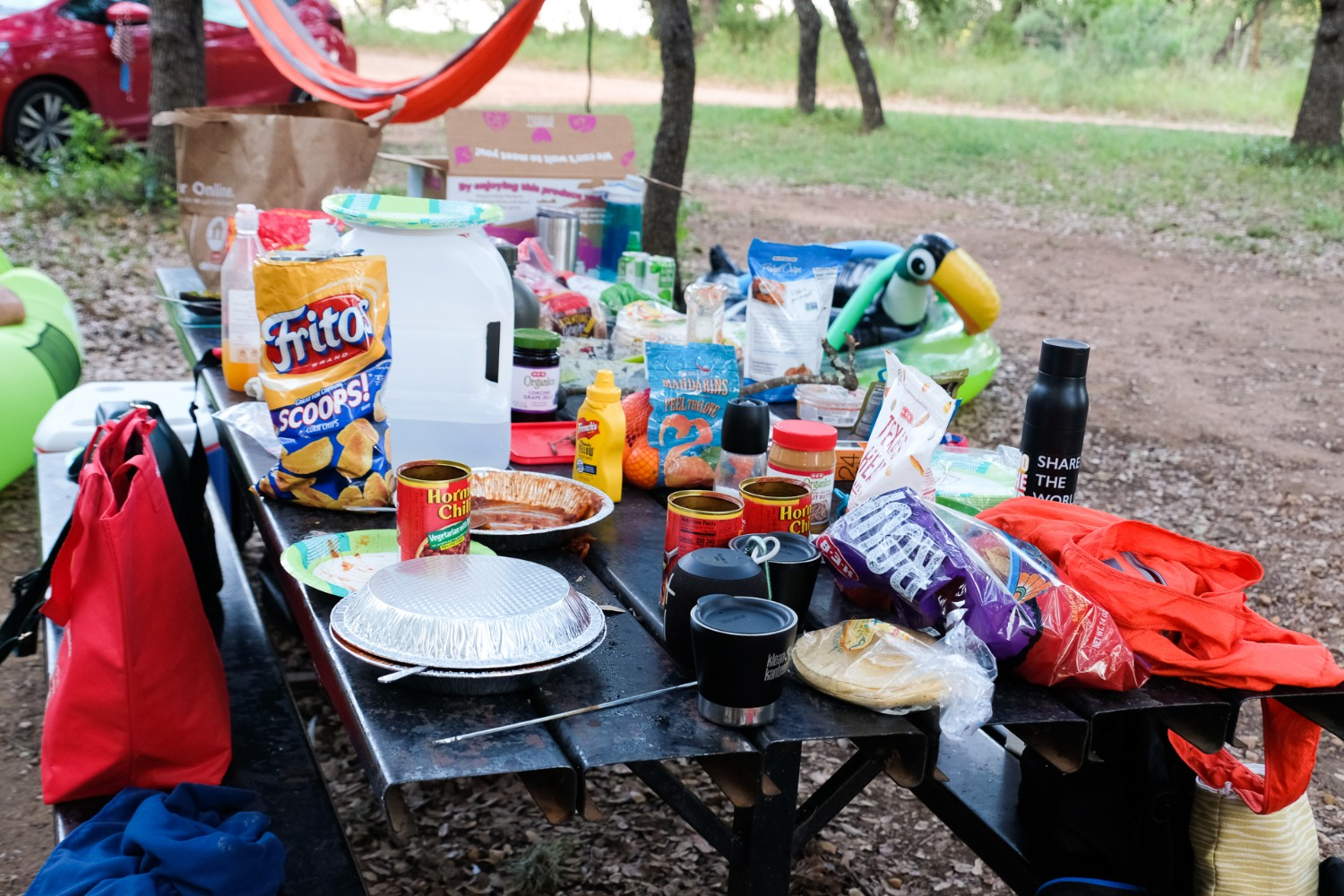 Table filled with snack foods while camping