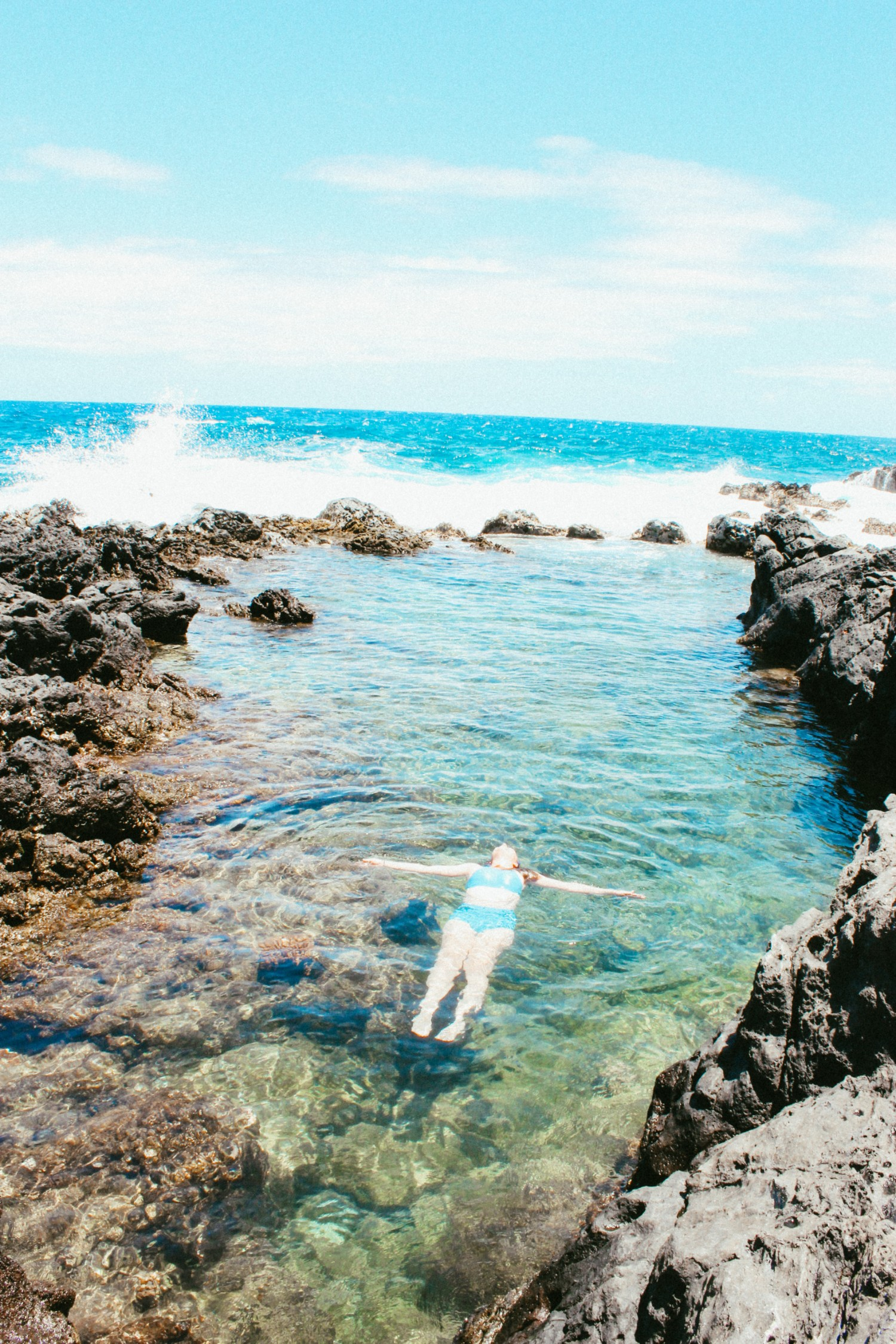 Kendal Karstens floating in the sea in Hawaii