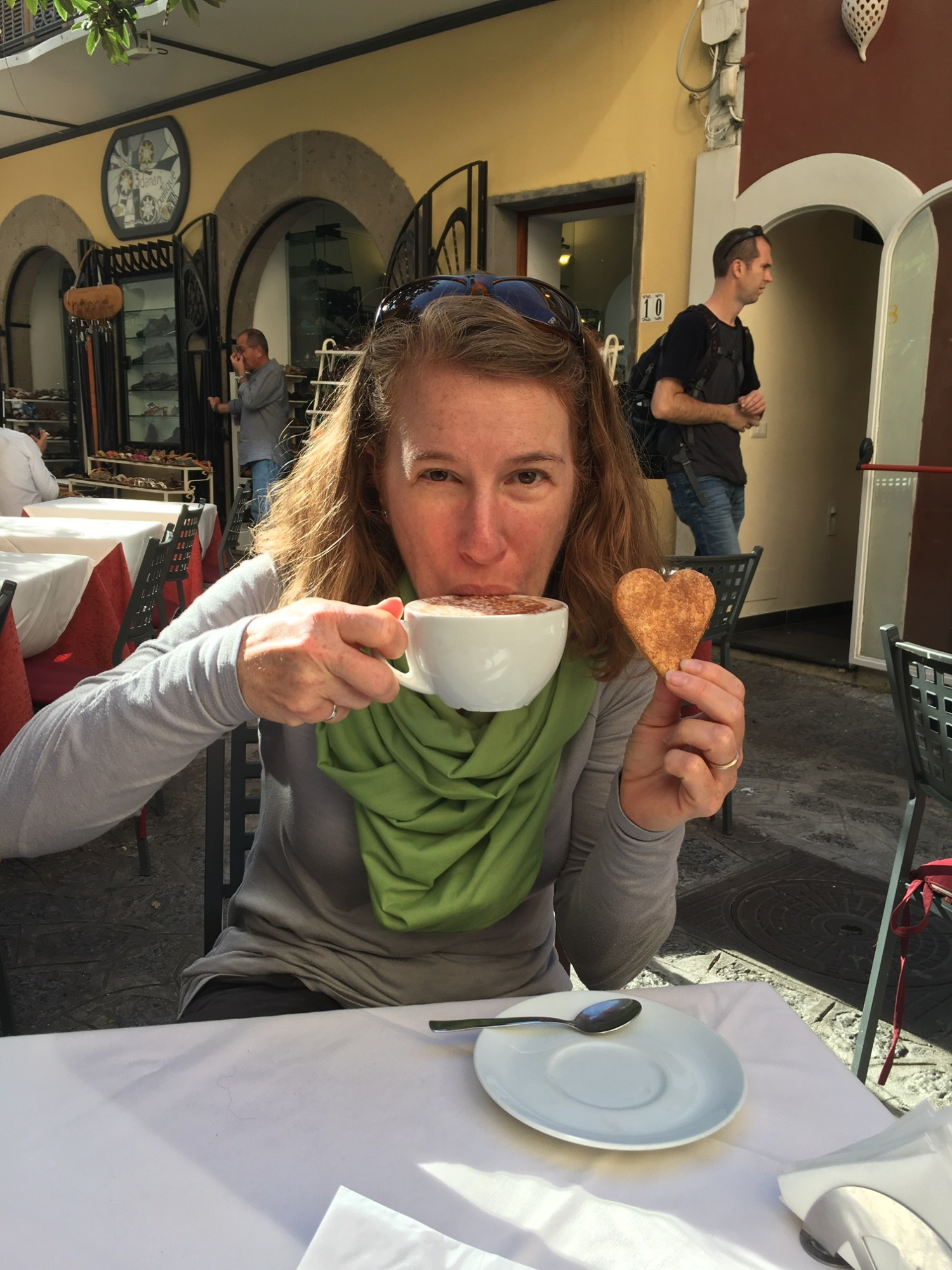Becki Rupp of Trailblazer Wellness sips a capuccino at a cafe in Italy she stumbled upon