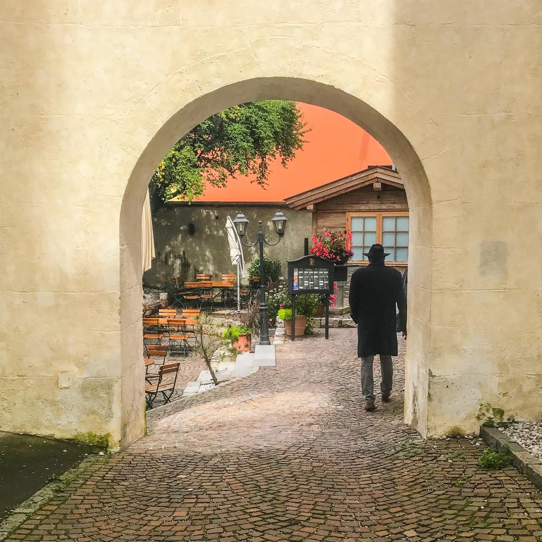 Man walking away through a cobbled lane in Innsbruck