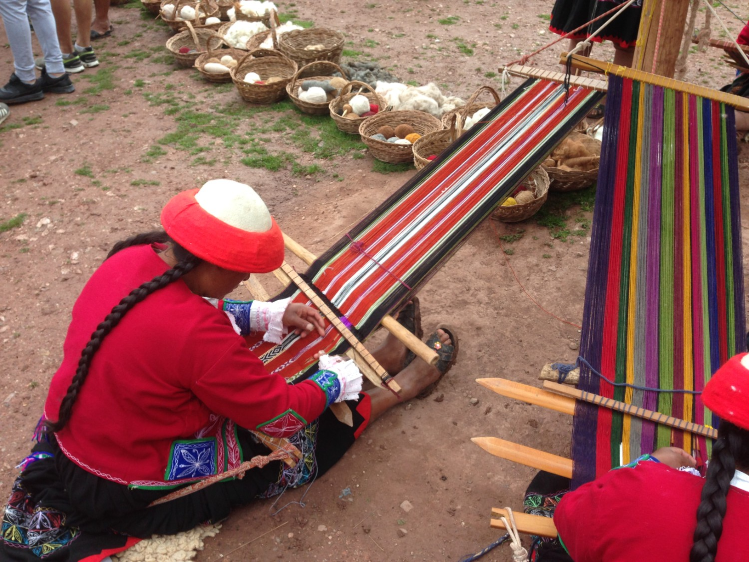 A woman in Ccaccaccollo Peru weaving in the traditional way