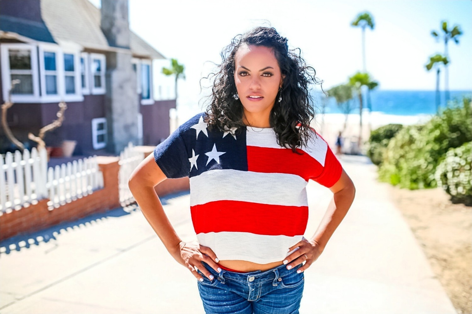 Karisma Shackelford creator of the Moving Forward event by Wanderful, standing in her USA flag shirt
