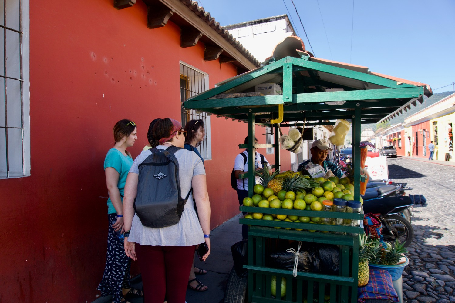 Tourists standing at a market stall in Guatemala