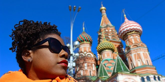 Black woman in front of a blue sky and St Basil's Cathedral in Moscow - PhocusWire feature quoting Wanderful