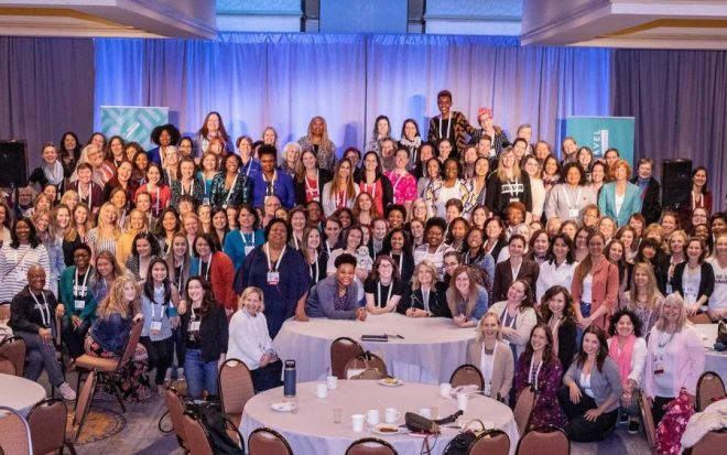 Women in Travel Summit by Wanderful - group photo on stage in Portland Maine 2019