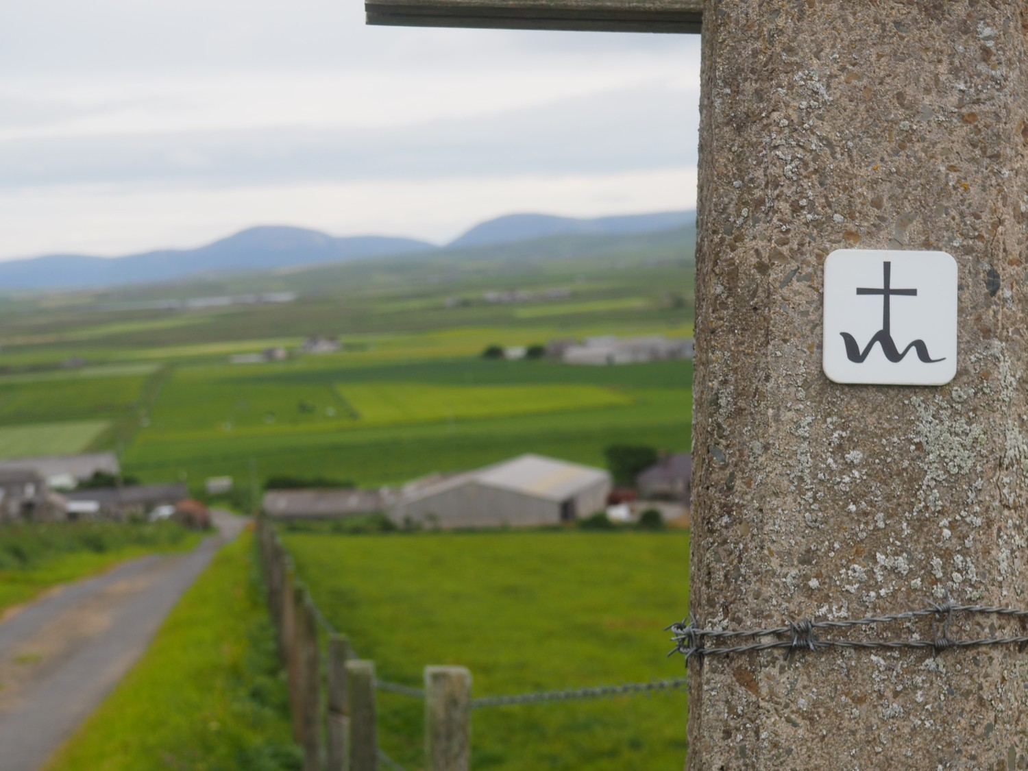 Small sign post to mark the St Magnus Way path in Orkney
