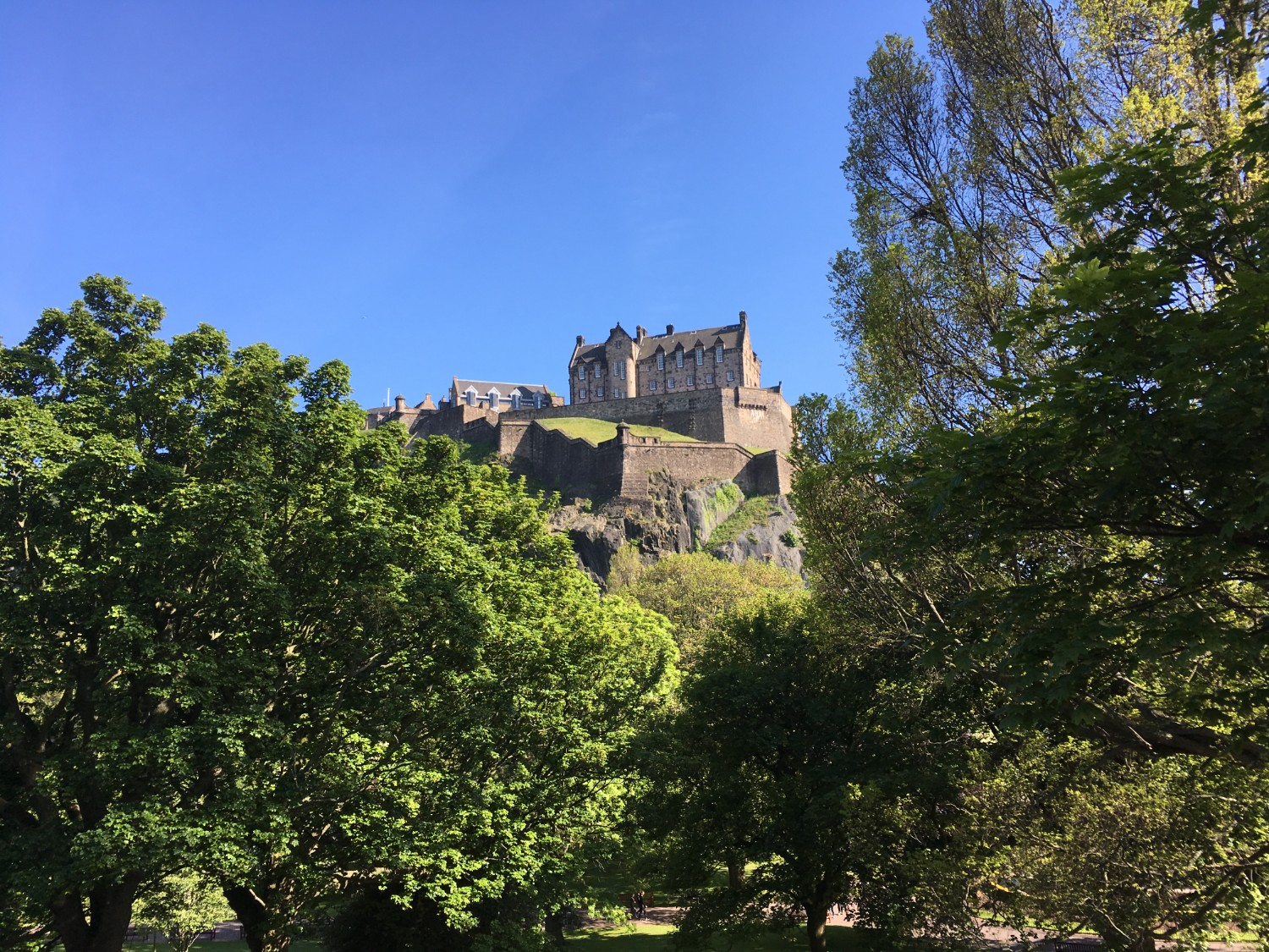 View of Edinburgh Castle against a clear blue sky - tips for planning a trip to Edinburgh from the Wanderful women's travel community