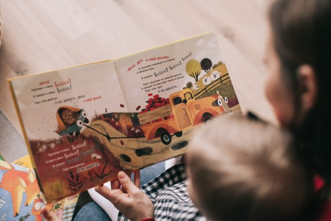 Travel books for kids -- woman reading with a small child