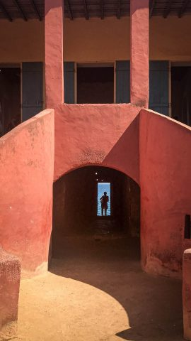 Orange building entrance in Goree island - photo by Larissa Rolley, photography course creator at Wanderful
