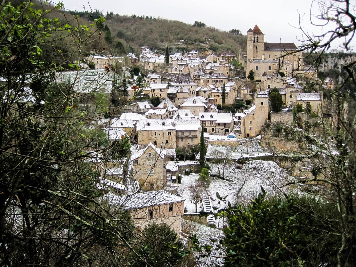 A light dusting of snow on rooftops in a French village - photo by Larissa Rolley, photography course creator at Wanderful