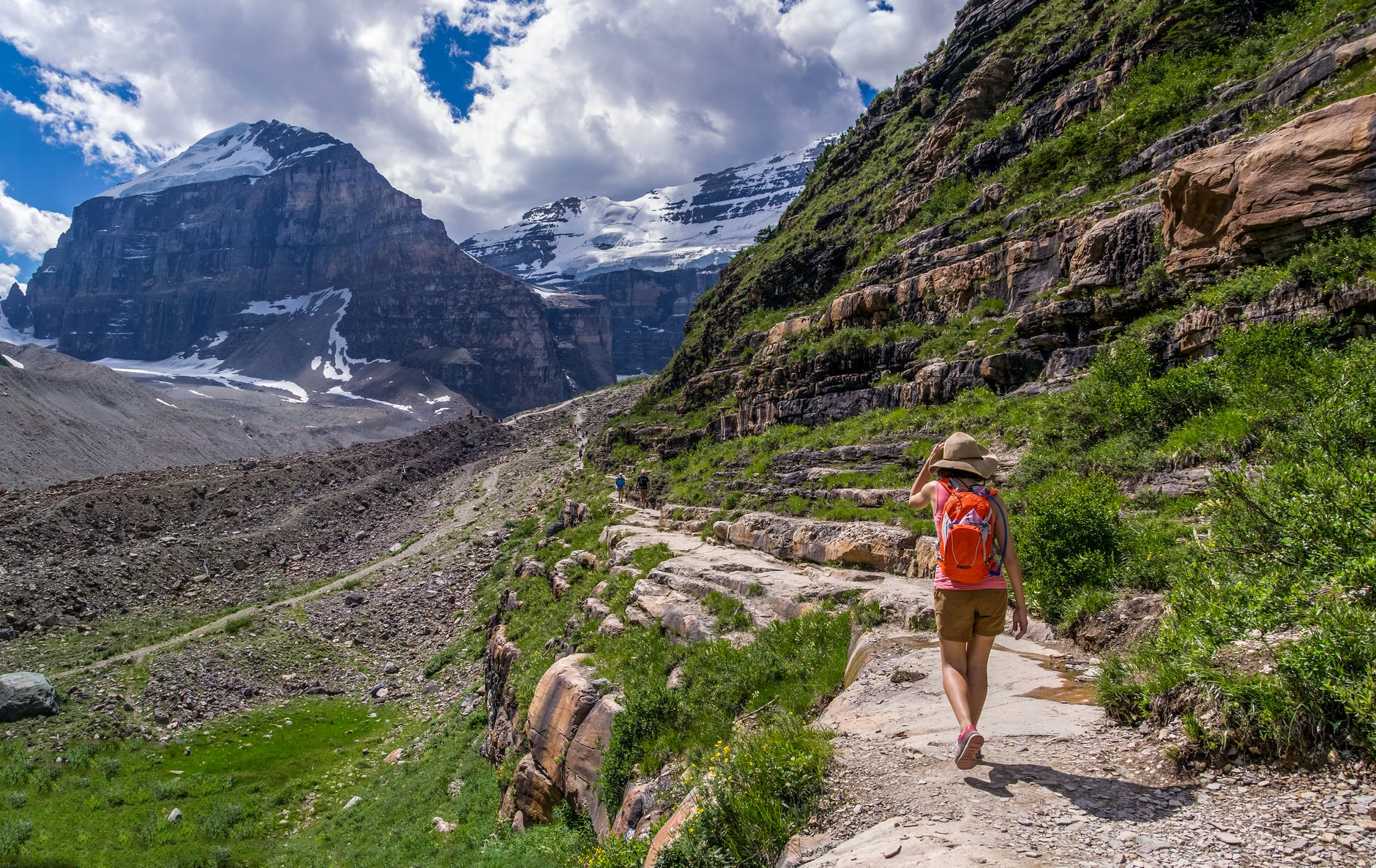 A person walking along a path in the mountains - get tips for adventure travel for women from Wanderful
