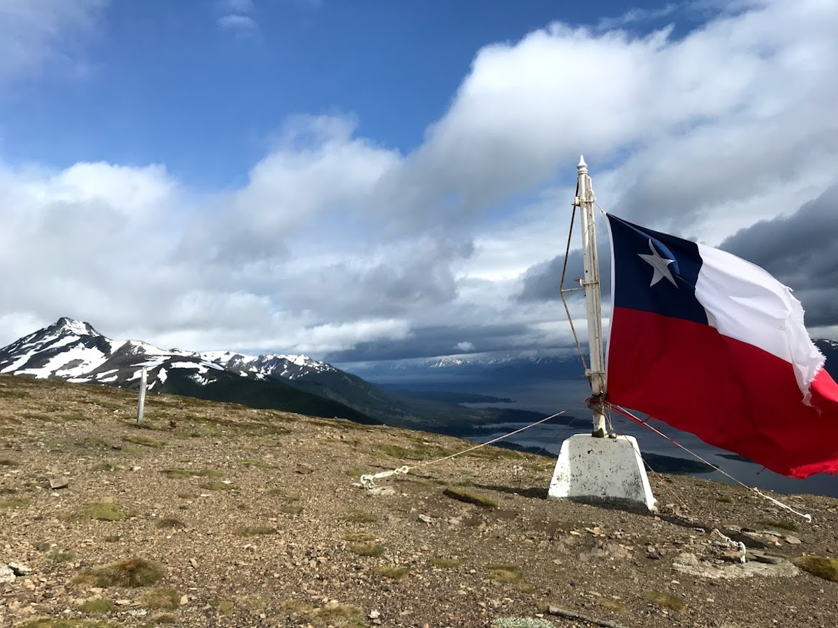 The end of the world with a Chilean flag atop the Cerro Bandera in Puerto Williams, Chile