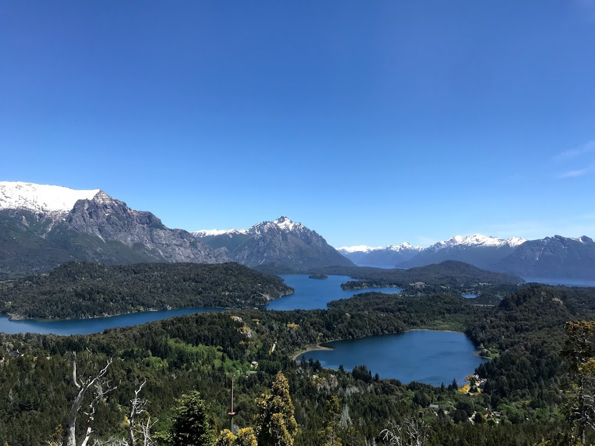 Stunning blue sky over the mountains and lakes of Patagonia from Cerro Campanario in Bariloche, Argentina.