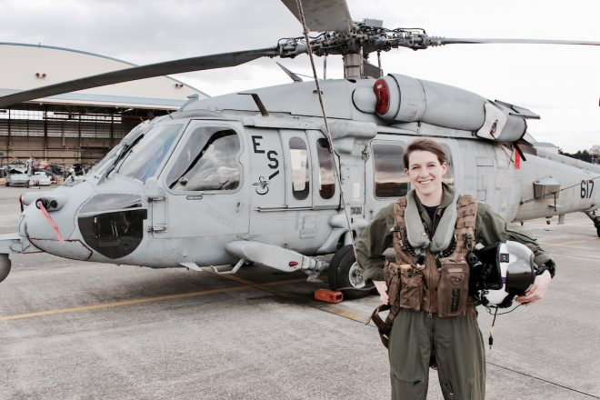 Shelby Dziwulski of Authenteco Travel standing in front of her US Navy Search and Rescue helicopter