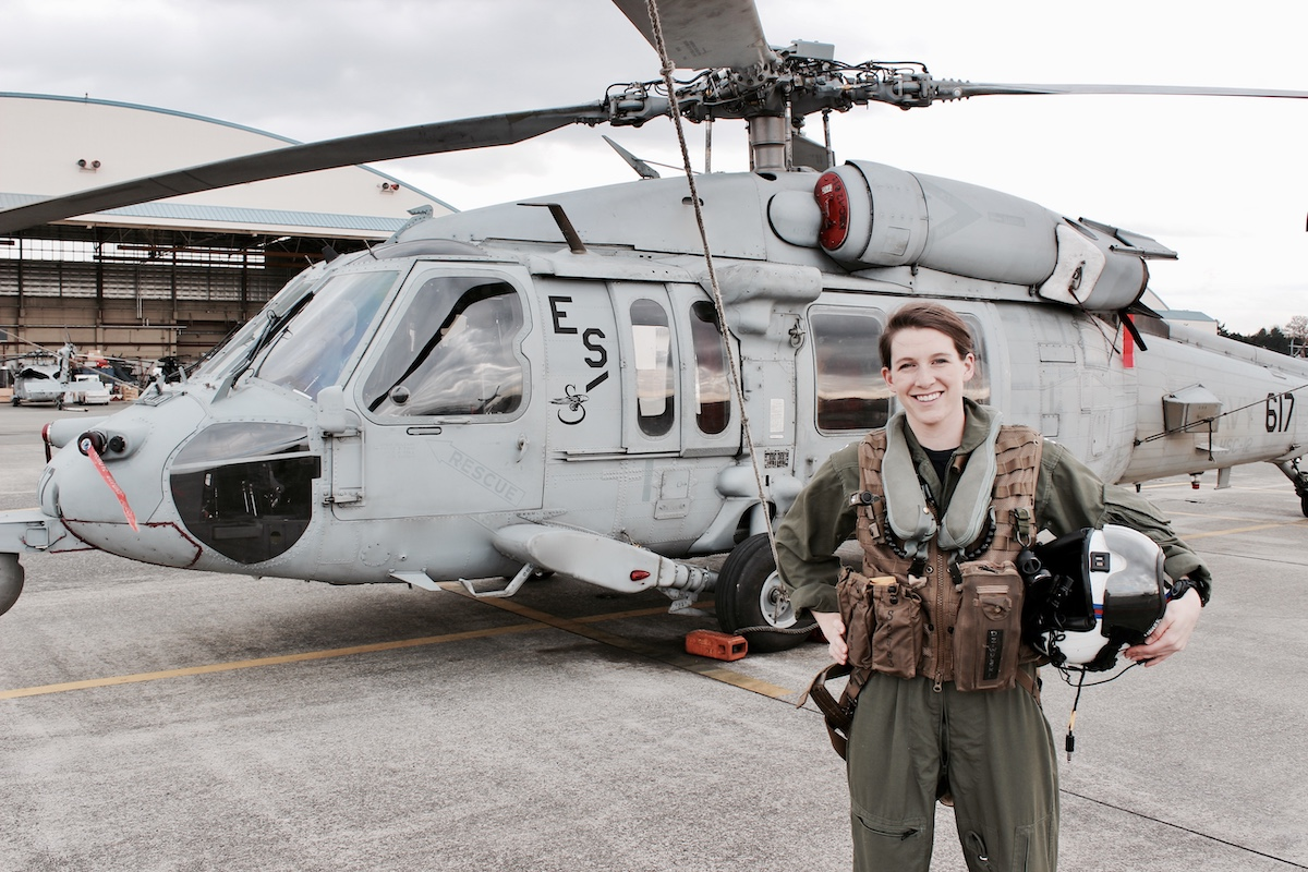Image of Shelby Dziwulski of Authenteco Travel and her helicopter