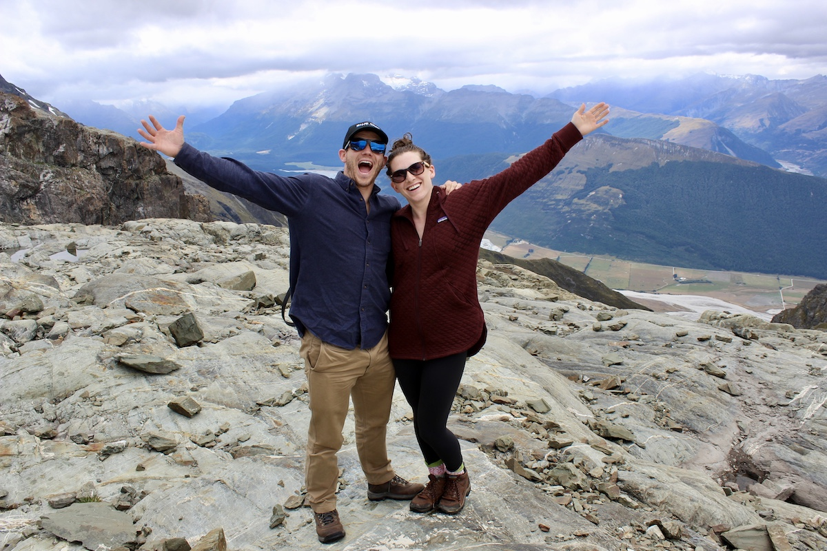 Shelby Dziwulski of Authenteco Travel and her husband pictured in the mountains in New Zealand, via Wanderful