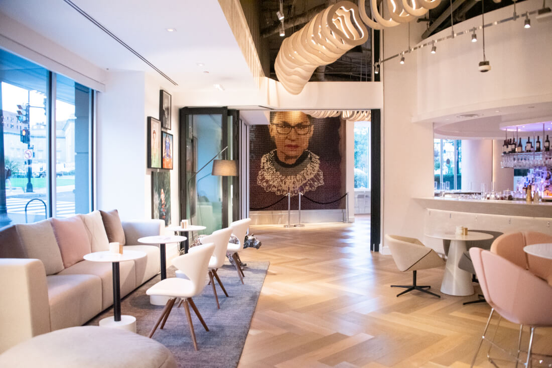 The lobby area of Hotel Zena with the Notorious RBG portrait at the far end