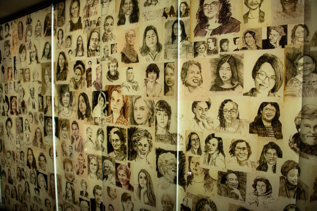 Wall filled with sketched portraits of famous women