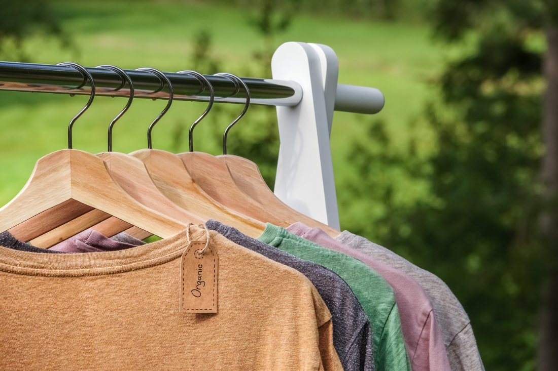 Shirts on hangers with an organic tag