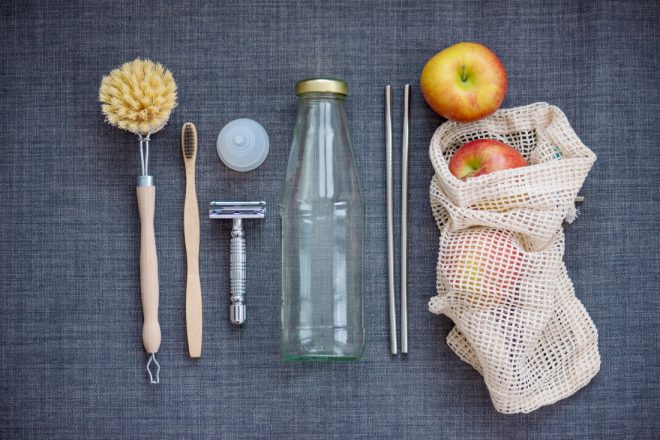 Sustainably made items, including bamboo products, cloth produce bag, glass bottle and metal straws